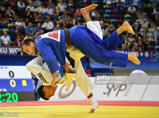 Georgii Zantanaraia fights against Russian Mikhail Puliaev during their under 66kg bout of the 2018 Judo World Championships in Baku on September 21...