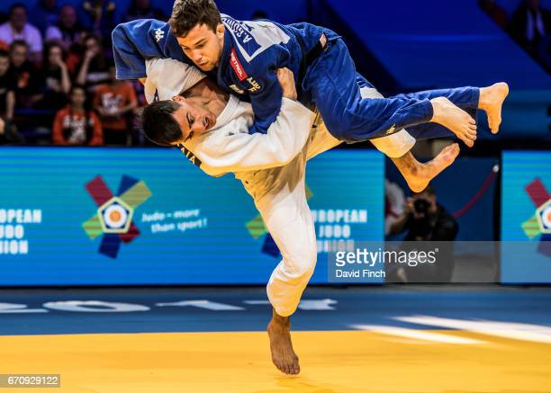 Georgii Zantaraia of Ukraine lifts Adrian Gomboc of Slovenia high into the air before throwing him for ippon to win the u66kg gold medal during the...