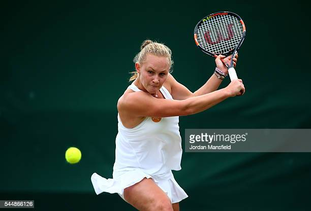 Georgina Axon of Great Britain plays a backhand during the Girl's singles first round match against Lara Salden of Belgium on day seven of the...
