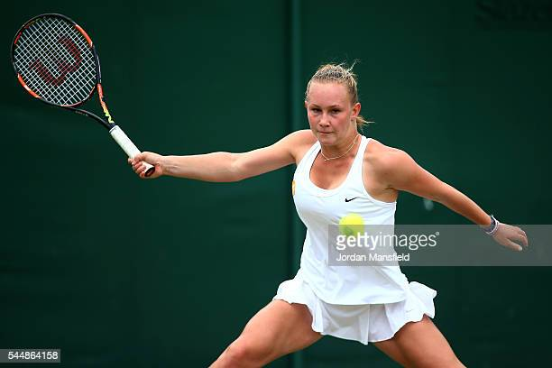 Georgina Axon of Great Britain plays a forehand during the Girl's singles first round match against Lara Salden of Belgium on day seven of the...