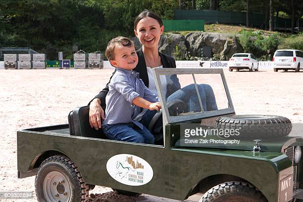 Georgina Bloomberg and son Jasper Michael Brown Quintana ride around in a Mini Landrover at Third Annual Rolex Central Park Horse Show Kick Off at...