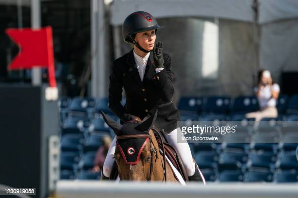 Georgina Bloomberg blows a kiss to her son during the $137,000 FEI NetJets Grand Prix at the Winter Equestrian Festival on January 31, 2021 at The...