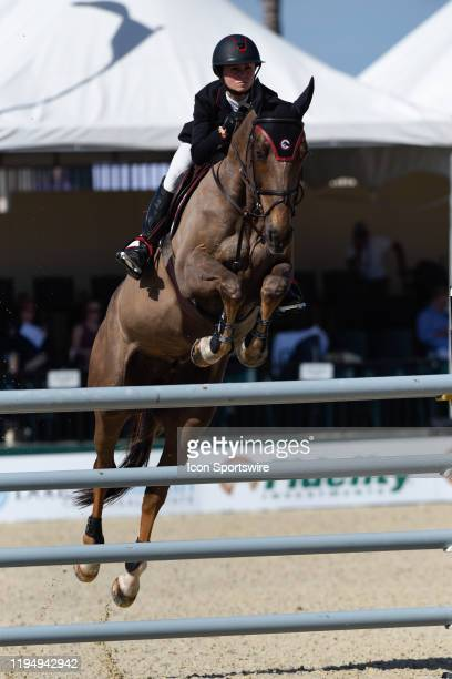 WELLINGTON FL JANUARY 19 Georgina Bloomberg riding Manhattan in action in the Winter Equestrian Festival Grand Prix CSI 2 event on January 19 at the...