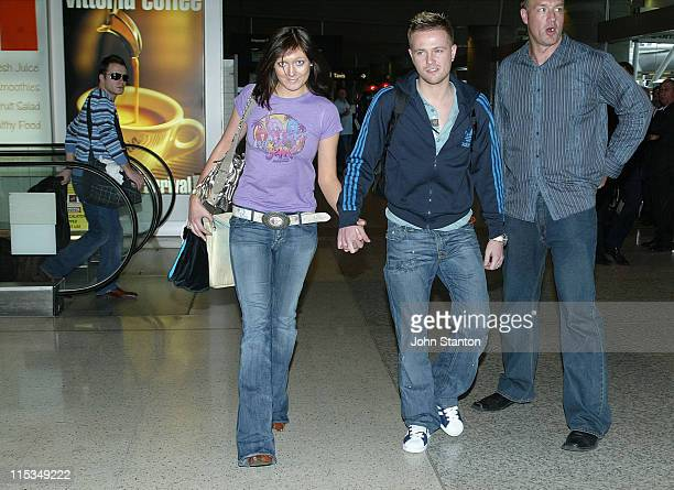Georgina Byrne and Nicky Byrne of Westlife during Westlife Sighting at the Sydney Airport March 1 2006 at Sydney Airport in Sydney NSW Australia