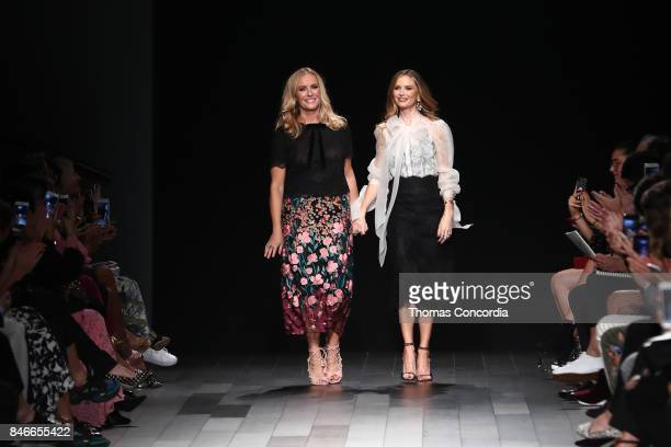 Georgina Chapman and Keren Craig greet the audience after presenting the Marchesa Spring 2018 collection during New York Fashion Week on September 13...