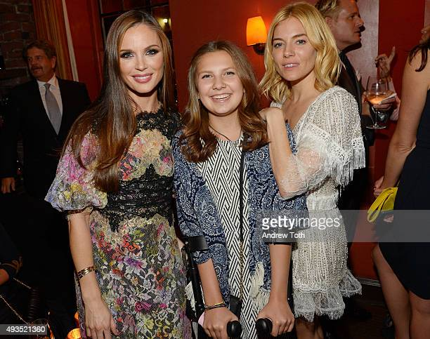 Georgina Chapman Carla Leone and Sienna Miller attend the New York premiere of BURNT presented by The Weinstein Company Sassoregale Wine Castello...