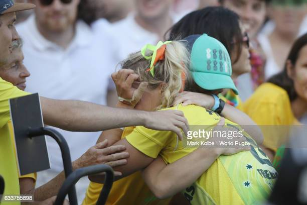 Georgina Friedricks of Australia is comforted by family in the crowd after defeat in the womens bronze cup match between New Zealand and Australia in...