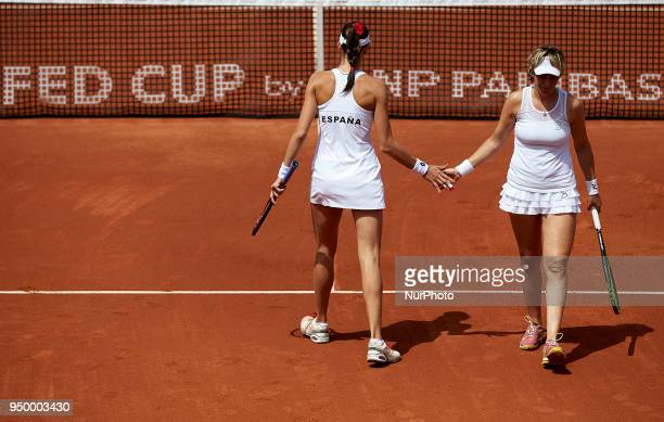 Georgina Garca Perez and Maria Jose Martnez of Spain celebrate a point in their doubles match against Montserrat Gonzalez and Veronica Cepede of...