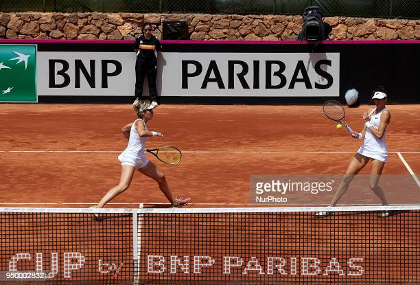 Georgina Garca Perez and Maria Jose Martnez of Spain in action in their doubles match against Montserrat Gonzalez and Veronica Cepede of Paraguay...