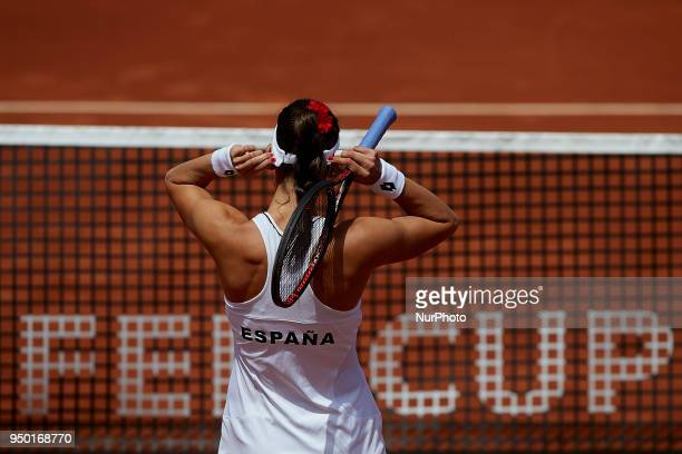 Georgina Garcia Perez of Spain reacts in her doubles match with Maria Jose Martinez against Montserrat Gonzalez and Veronica Cepede of Paraguay...
