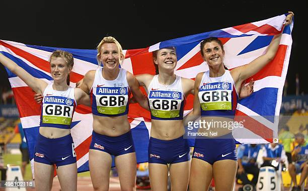 Georgina Hermitage Maria Lyle Olivia Breen and Sophie Hahn of Great Britain celebrate winning gold in the women's 4x100m T3538 final during the...
