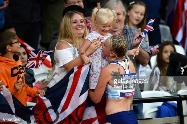 Georgina Hermitage of Great Britain celebrates with her family after winning gold in the final of the womens 100m T37 on day nine of the IPC World...