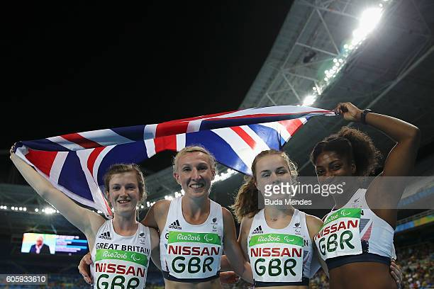 Georgina Hermitage Sophie Hahn Maria Lyle and Kadeena Cox of Great Britain pose for photographers after finishing second in the women's 4x100 meter...