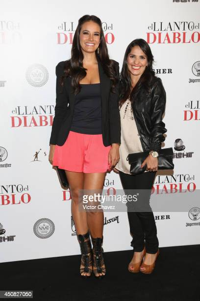 Georgina Holguin and Noemi Gonzalez attend Nothing Left to Fear Mexico City premiere black carpet at Cinepolis Diana on June 17 2014 in Mexico City...