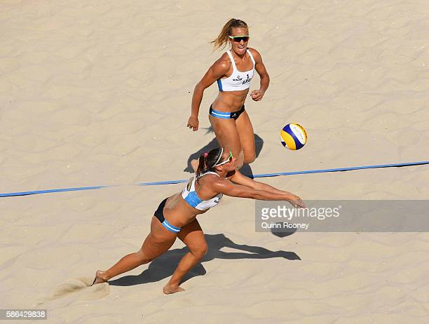 Georgina Klug and Ana Gallay of Argentina in action during the Women's Beach Volleyball preliminary round Pool B match against Liliana Fernandez...