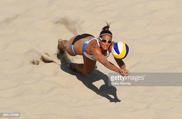 Georgina Klug of Argentina dives for the ball during the Women's Beach Volleyball preliminary round Pool B match against Liliana Fernandez Steiner...