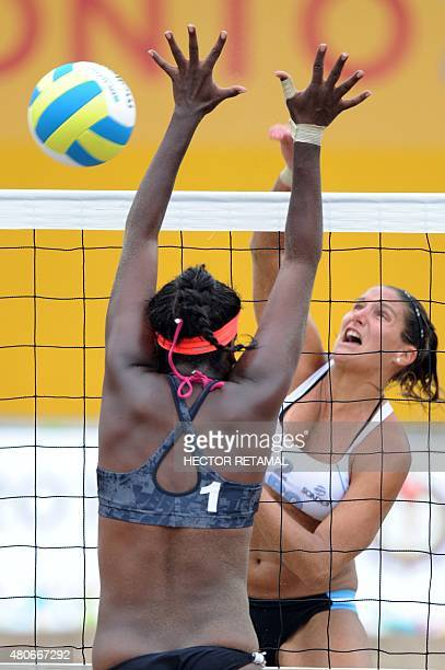 Georgina Klug of Argentina vies for the ball with Ayana Dyette of Trinidad and Tobago during the Women's Beach Voleyball Preliminary at the 2015 Pan...