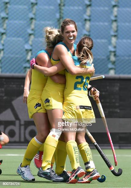 Georgina Morgan of Australia is hugged by team mates after scoring during the FINTRO Women's Hockey World League SemiFinal Pool B game between...