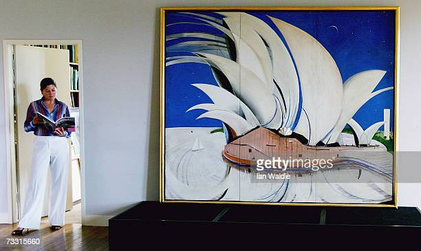 Georgina Pemberton head of Australian paintings at Sotheby's auctioneers stands next to artist Brett Whiteley's work 'Opera House' during the...