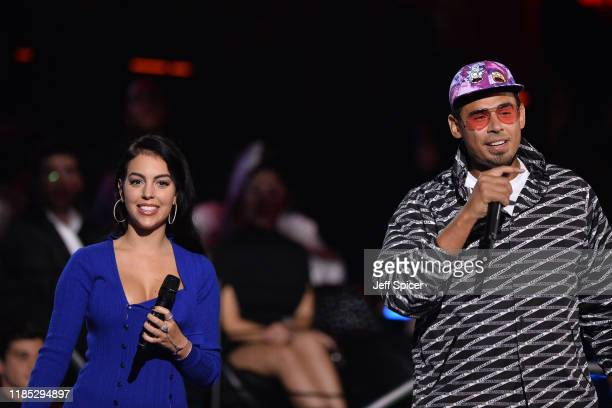 Georgina Rodriguez and Afrojack present the Best Collaboration Award on stage during the MTV EMAs 2019 at FIBES Conference and Exhibition Centre on...