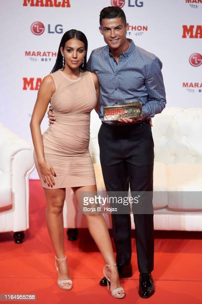 Georgina Rodriguez and Cristiano Ronaldo posing to media with 'Marca Leyenda' Award on July 29 2019 in Madrid Spain