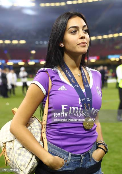 Georgina Rodriguez partner of Cristiano Ronaldo of Real Madrid looks on wearing a winners trophy after the UEFA Champions League Final between...