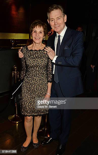 Georgina Simpson and Anthony Andrews attend the press night after party of How The Other Half Loves at Mint Leaf on March 31 2016 in London England