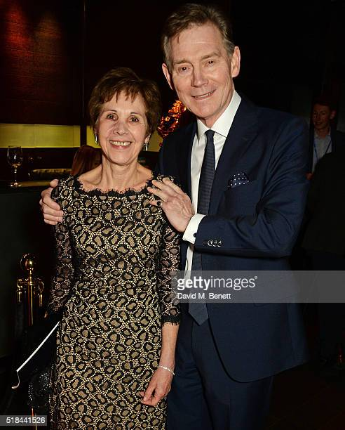 Georgina Simpson and Anthony Andrews attend the press night after party of 'How The Other Half Loves' at Mint Leaf on March 31 2016 in London England