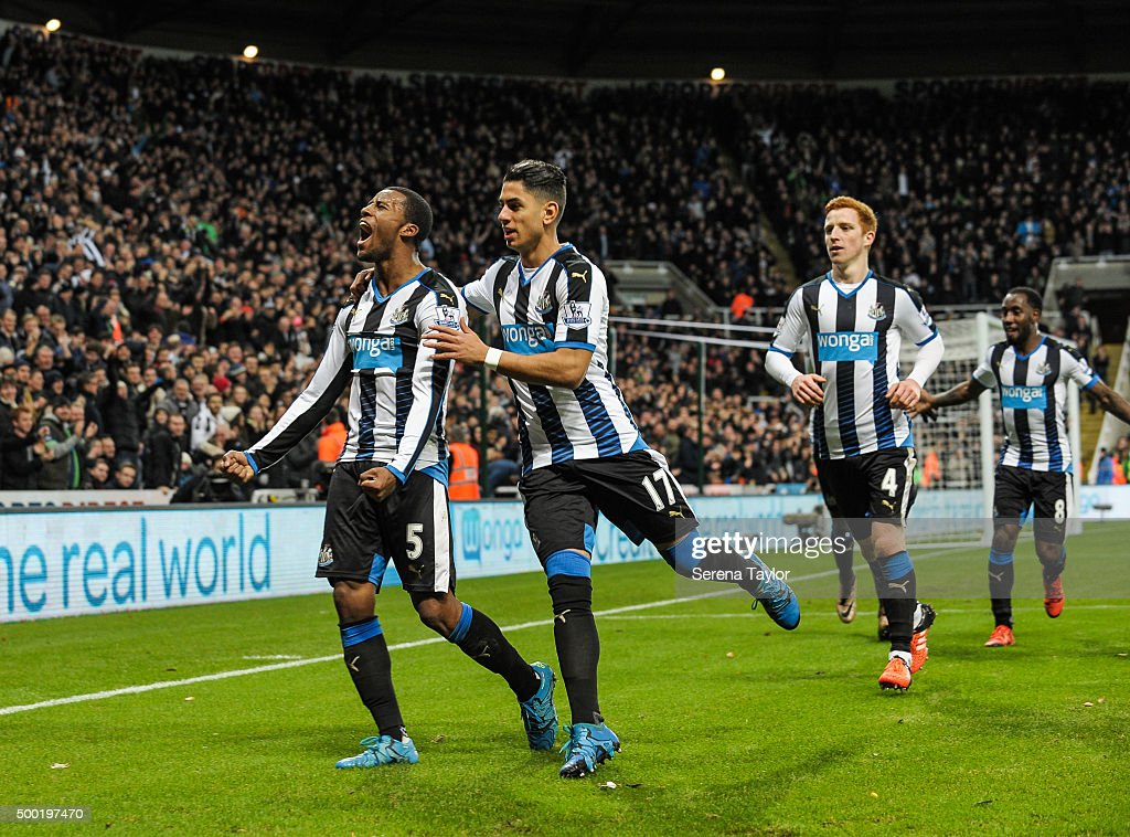 Georgina Wijnaldum (L) of Newcastle celebrates with teammates seen L-R Ayoze Perez, Jack Colback and Vurnon Anita after scoring the opening goal during the Barclays Premier League match between Newcastle United and Liverpool at St.James' Park on December 6, 2015, in Newcastle upon Tyne, England.