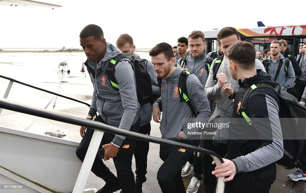 Georginio Wijnaldum and Andrew Robertson of Liverpool board the plane for their trip to Porto at Liverpool John Lennon Airport on February 13, 2018 in Liverpool, England.