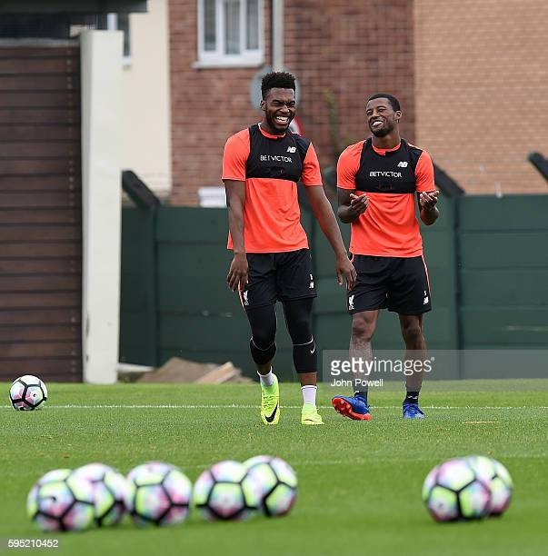 Georginio Wijnaldum and Daniel Sturridge of Liverpool during a training session at Melwood Training Ground on August 25 2016 in Liverpool England
