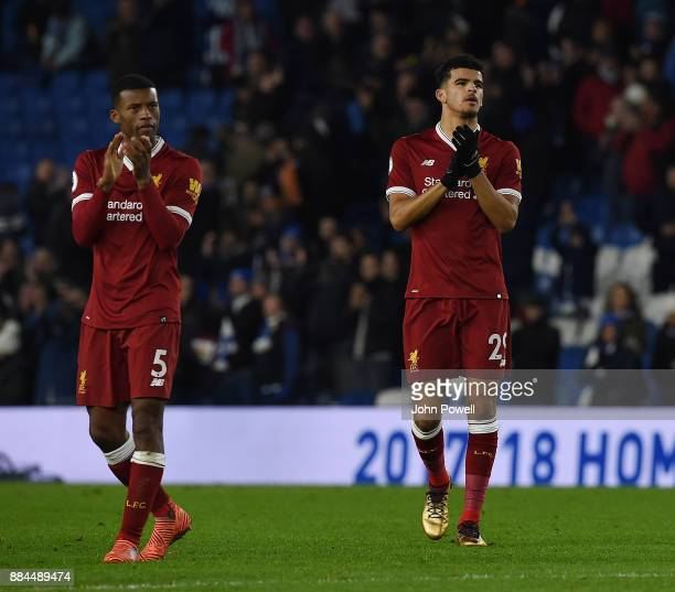 Georginio Wijnaldum and Dominic Solanke of Liverpool show their appreciation to the fans at the end of the Premier League match between Brighton and...