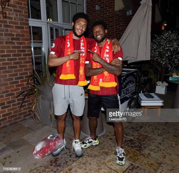 Georginio Wijnaldum and Joe Gomez of Liverpool celebrating winning the Premier League on June 25, 2020 in Liverpool, England.