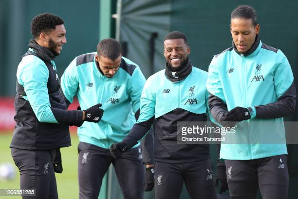 Georginio Wijnaldum and Joe Gomez of Liverpool laugh during a training session at Melwood Training Ground on February 17 2020 in Liverpool United...