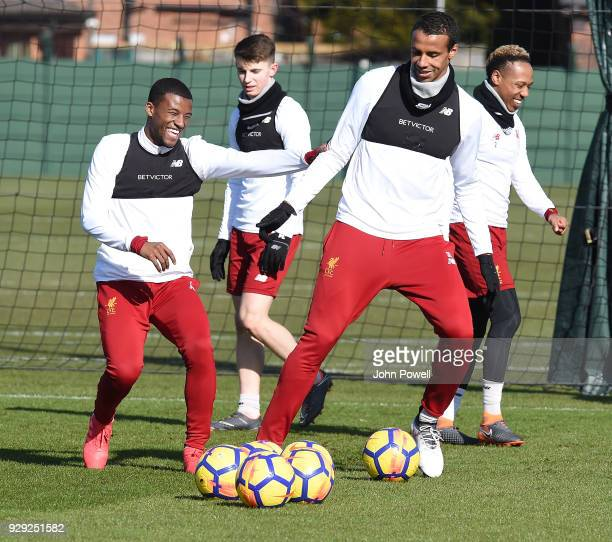 Georginio Wijnaldum and Joel Matip of Liverpool during a training session at Melwood Training Ground on March 8 2018 in Liverpool England