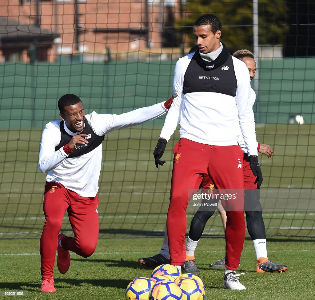 Georginio Wijnaldum and Joel Matip of Liverpool during a training session at Melwood Training Ground on March 8, 2018 in Liverpool, England.