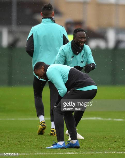 Georginio Wijnaldum and Naby Keita of Liverpool during a training session at Melwood Training Ground on February 21 2020 in Liverpool England