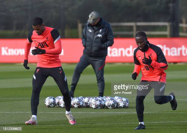 Georginio Wijnaldum and Naby Keita of Liverpool during a training session at AXA Training Centre on April 13, 2021 in Kirkby, England.