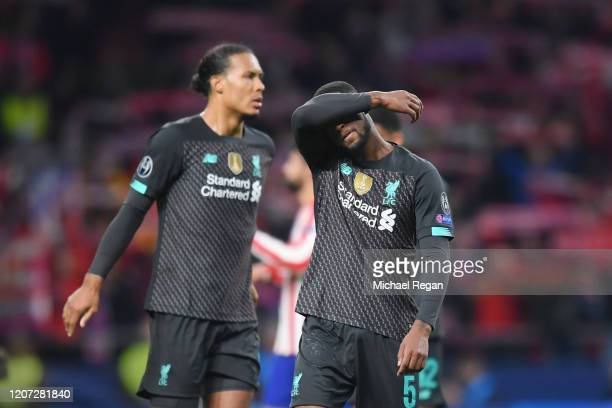 Georginio Wijnaldum and Virgil van Dijk of Liverpool look dejected after the UEFA Champions League round of 16 first leg match between Atletico...