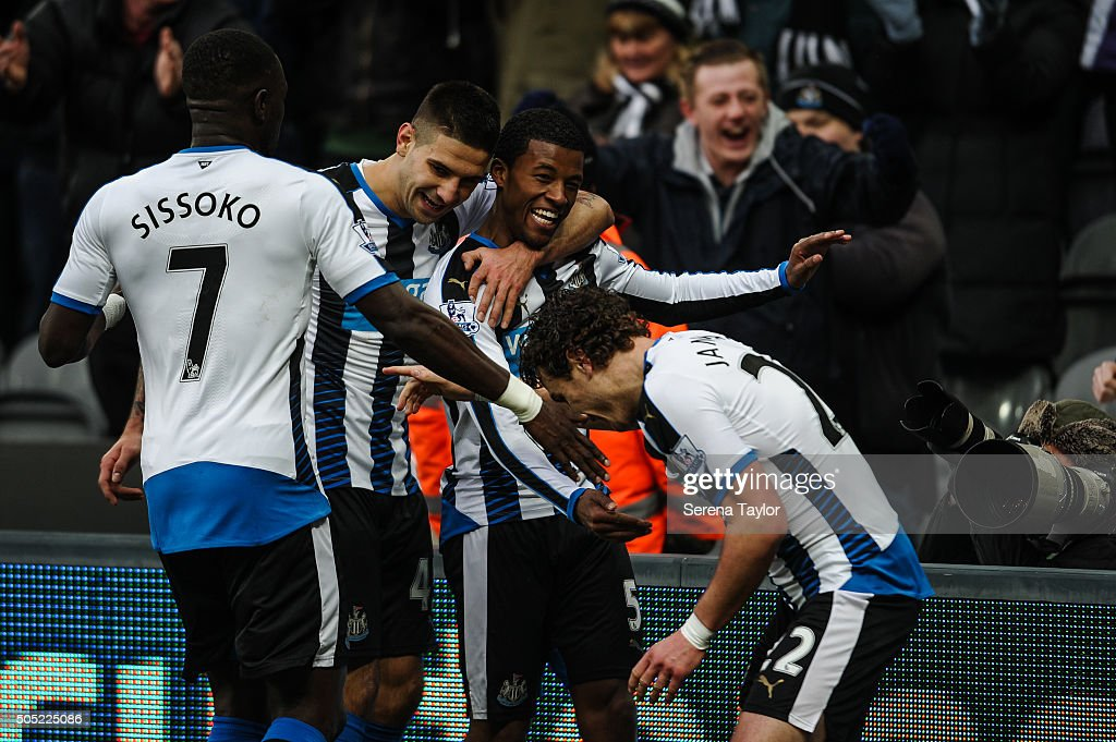 Georginio Wijnaldum (R) celebrates with teammates after scoring their second goal during the Barclays Premier League match between Newcastle United and West Ham United at St.James' Park on January 16, 2016, in Newcastle upon Tyne, England.
