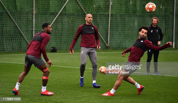 Georginio Wijnaldum Fabinho and Mohamed Salah of Liverpool during a training session on February 15 2019 in Marbella Spain