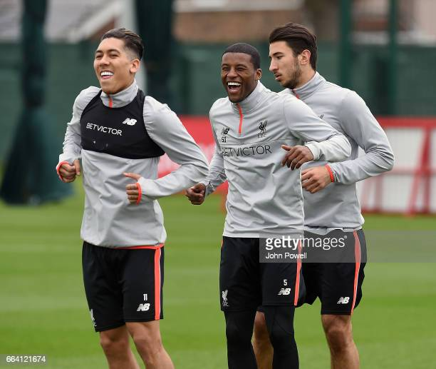 Georginio Wijnaldum laughing with Roberto Firmino of Liverpool during a training session at Melwood Training Ground on April 3 2017 in Liverpool...