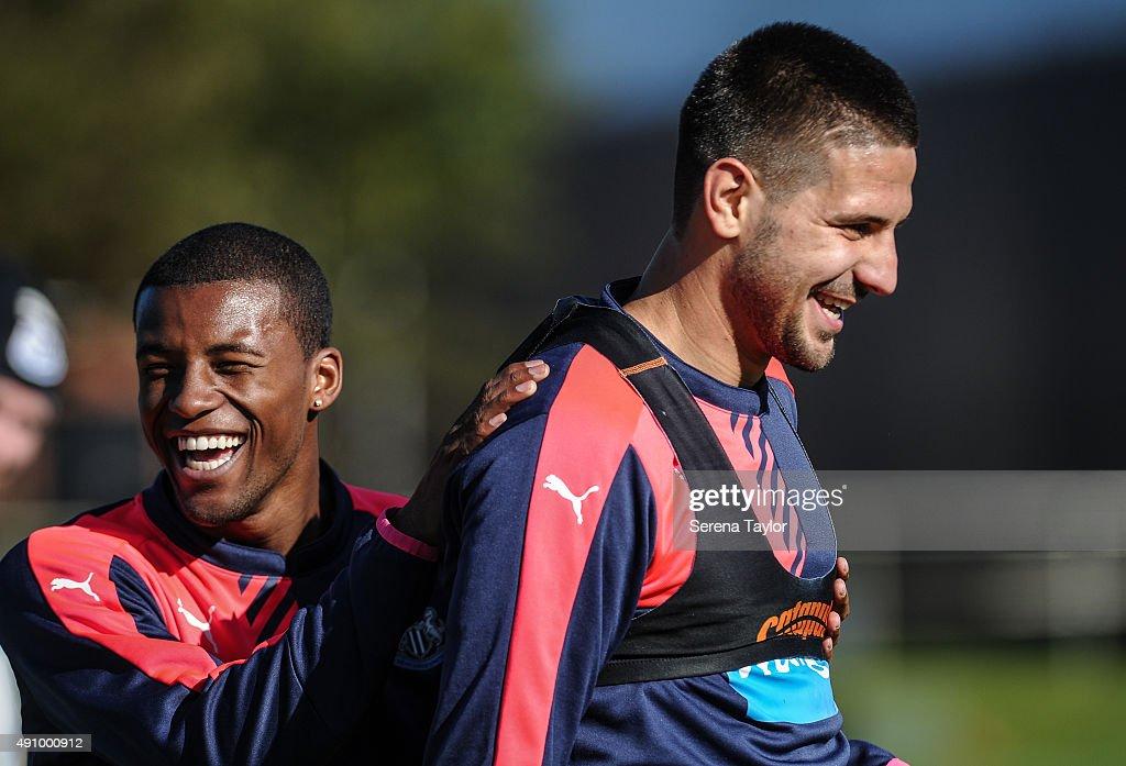 Georginio Wijnaldum (L) laughs with Aleksandar Mitrovic (R) during the Newcastle United Training session at The Newcastle United Training Centre on October 2, 2015, in Newcastle upon Tyne, England.