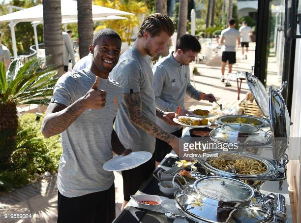 Georginio Wijnaldum Loris Karius and Andrew Robertson of Liverpool preparing lunch after a training session at Marbella Football Center on February...