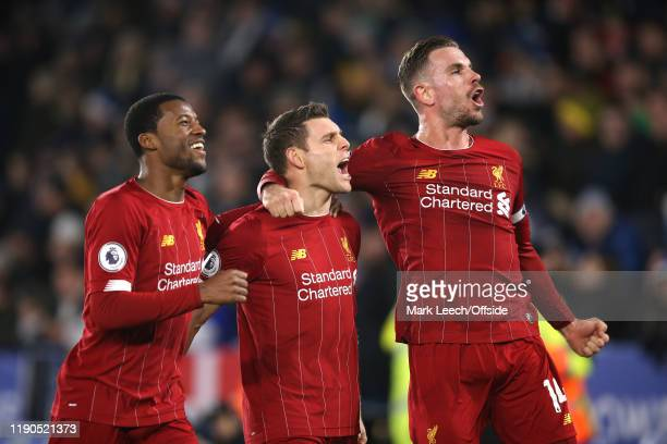 Georginio Wijnaldum of and Jordan Henderson Liverpool celebrates the second goal scored by James Milner of Liverpool during the Premier League match...