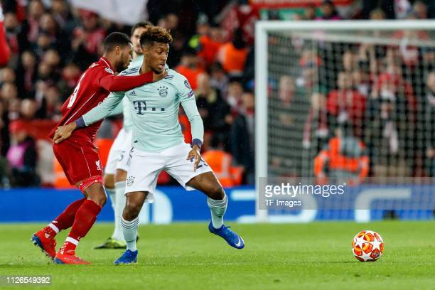 Georginio Wijnaldum of FC Liverpool and Kingsley Coman of Bayern Muenchen battle for the ball during the UEFA Champions League Round of 16 First Leg...