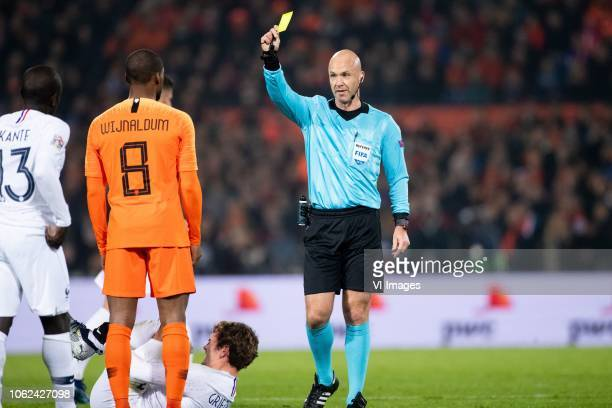 Georginio Wijnaldum of Holland Antoine Griezmann of France referee Anthony Taylor during the UEFA Nations League A group 1 qualifying match between...
