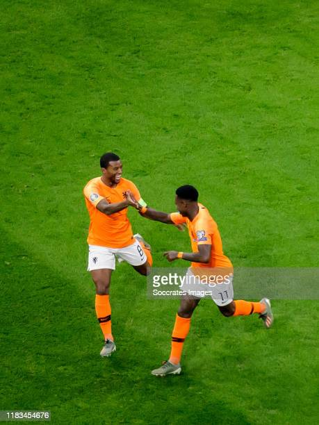 Georginio Wijnaldum of Holland celebrates 1-0 with Quincy Promes of Holland during the EURO Qualifier match between Holland v Estonia at the Johan...