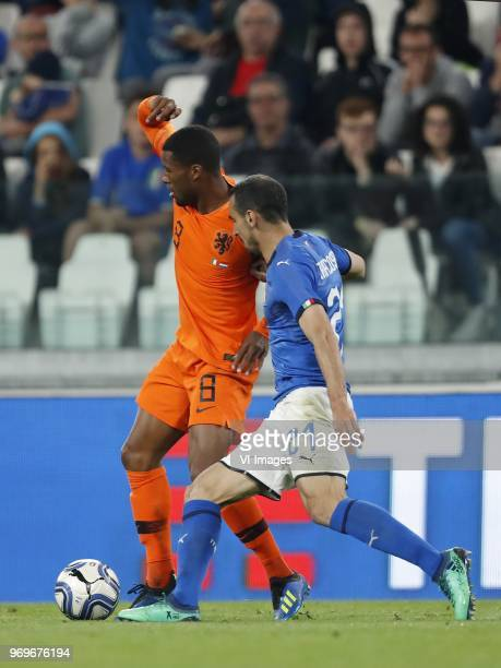 Georginio Wijnaldum of Holland Davide Zappacosta of Italy during the International friendly match between Italy and The Netherlands at Allianz...