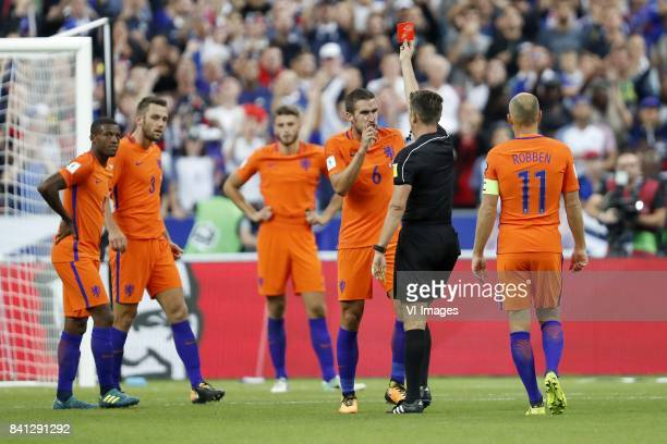Georginio Wijnaldum of Holland Stefan de Vrij of Holland Wesley Hoedt of Holland Kevin Strootman of Holland referee Gianluca Rocchi Arjen Robben of...